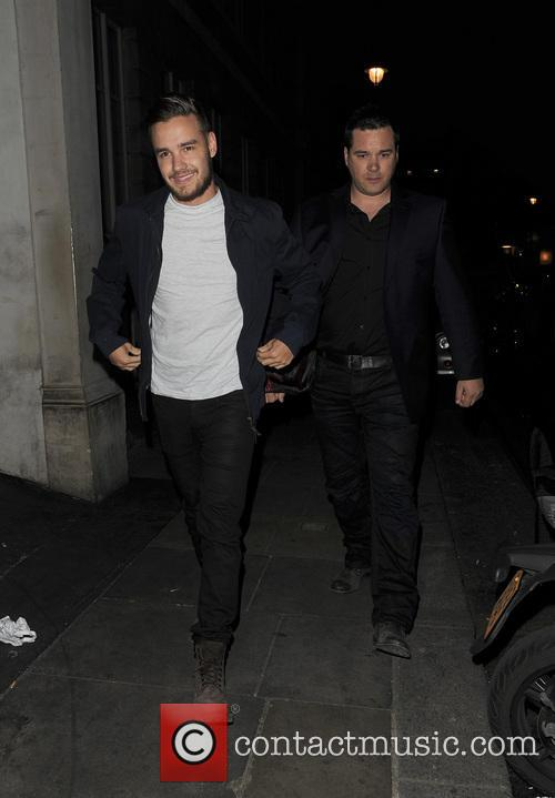 Harry Styles and Liam Payne from boyband One Direction, greet fans outside a hotel