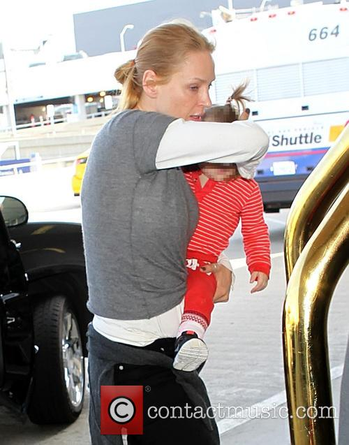 Uma Thurman at LAX with daughter Luna