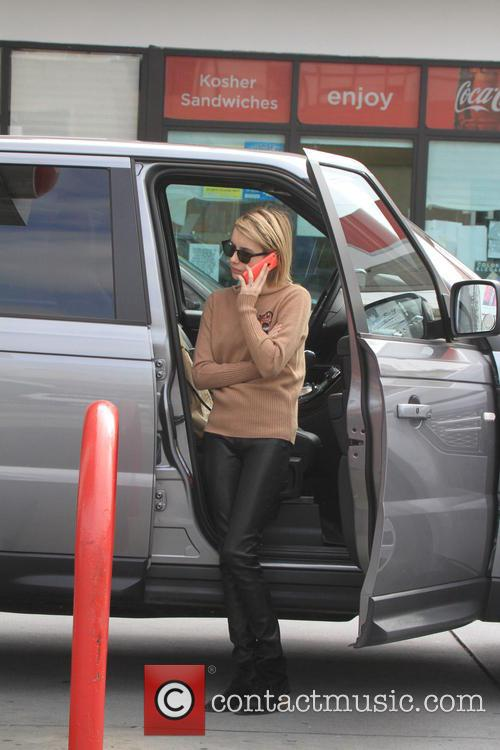 Emma Roberts seen filling up at a gas...