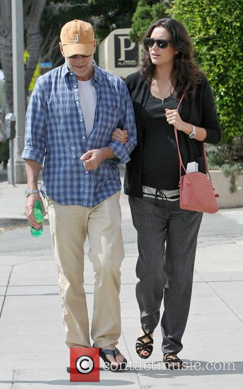 Bruce Willis and wife Emma go for a...
