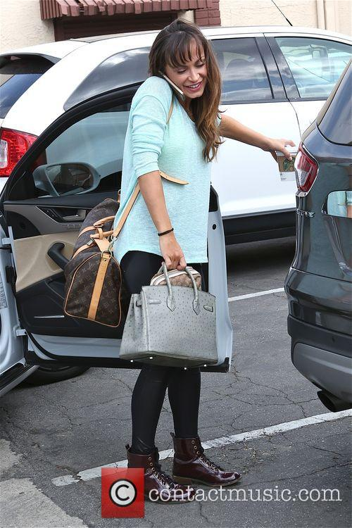 Karina Smirnoff brings her coffee to dancing practice