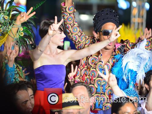 Anne Hathaway and Carlinhos Brown