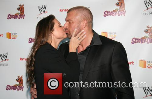 Triple H, Stephanie Mcmahon and Paul Michael Levesque 8