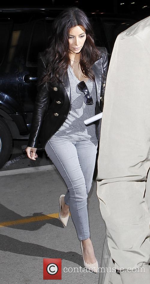 Kanye West and Kim Kardashian arrive at Los...