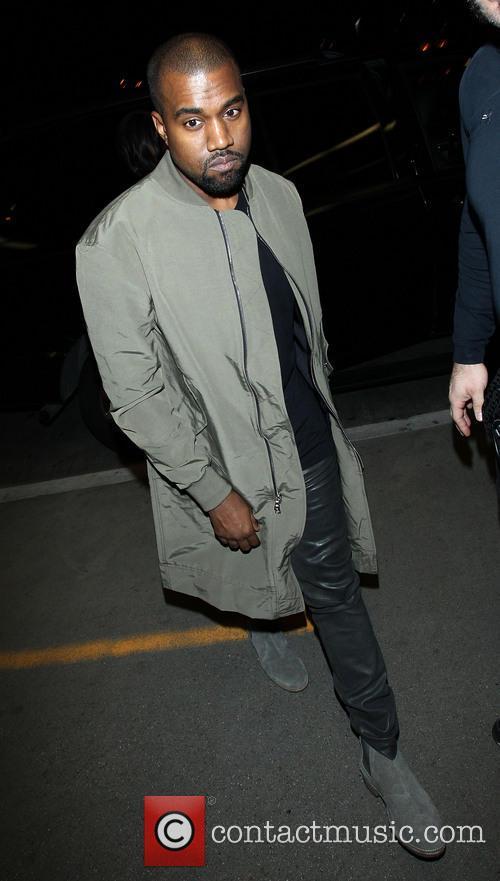 Kanye West and Kim Kardashian arrive at LAX