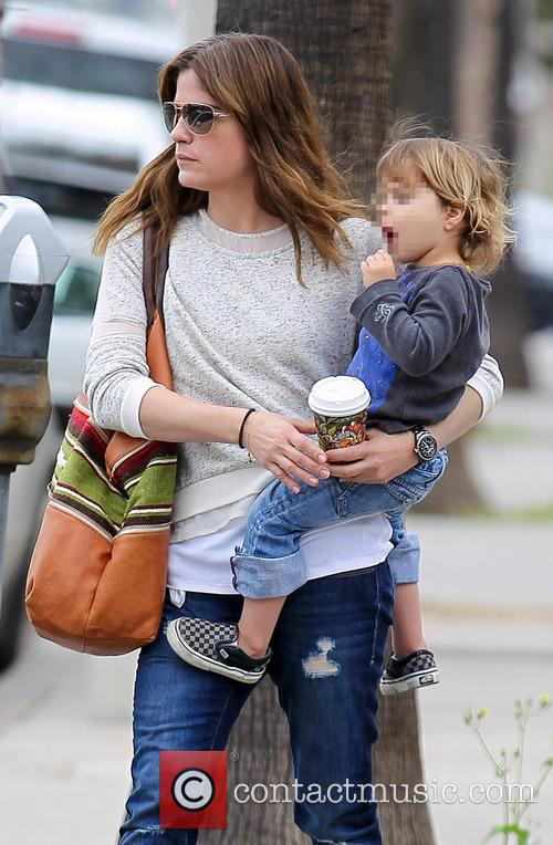 Selma Blair returns to her car with son...