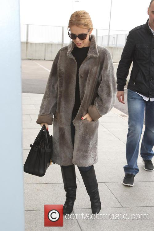 Kylie Minogue leaving Heathrow