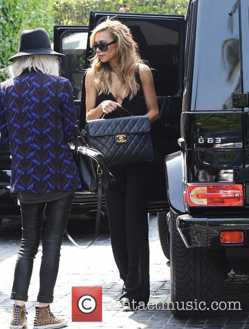 Naya Rivera shows off her cleavage as she...
