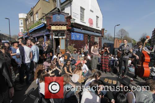 Londoners revel in the spring sunshine on Saturday...