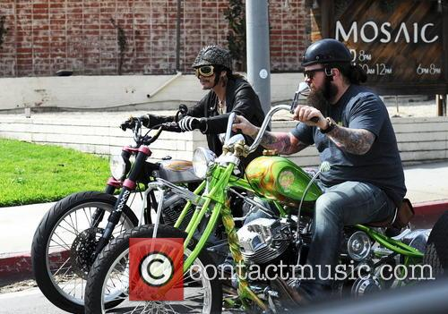 Steven Tyler seen cruising around Hollywood Boulevard on...