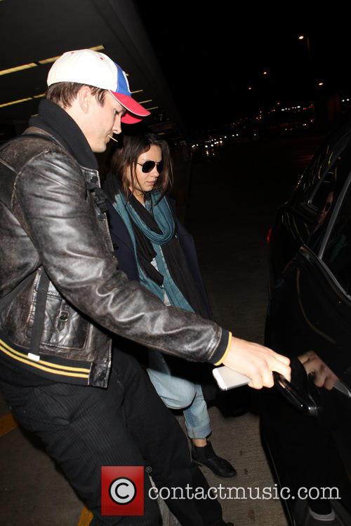 Ashton Kutcher and Mila Kunis at LAX