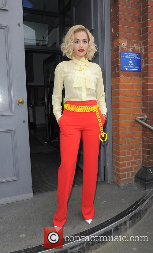 Rita Ora leaving a recording studio, wearing bright...