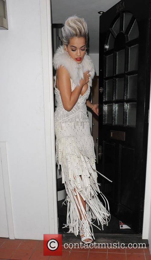 Rita Ora leaving her home in a typically...