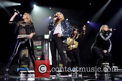The Backstreet Boys performing live in concert with...