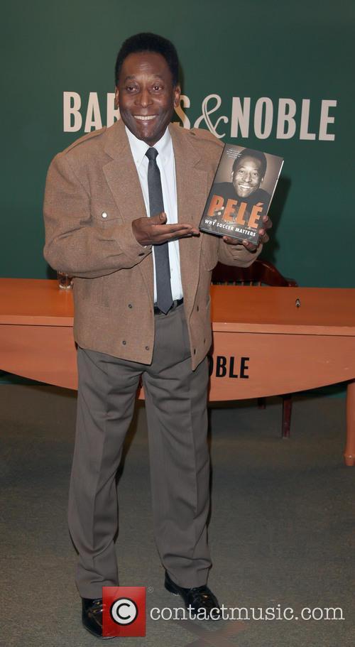 Brazilian soccer legend Pele presents his new book...