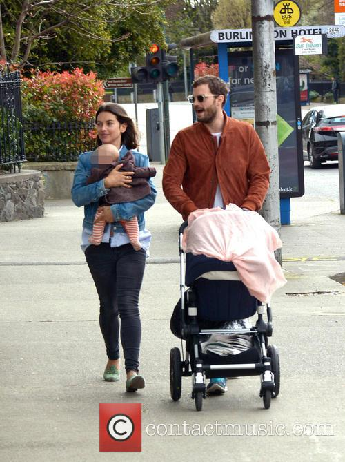 Jamie Dornan takes a stroll with his wife...