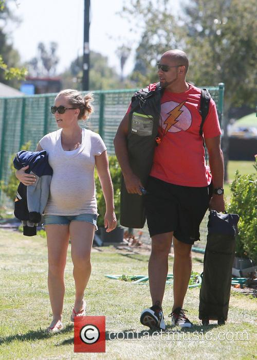 Kendra Wilkinson and Hank Baskett leaving their son's...