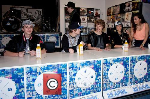 The Fooo sign copies of their new album...