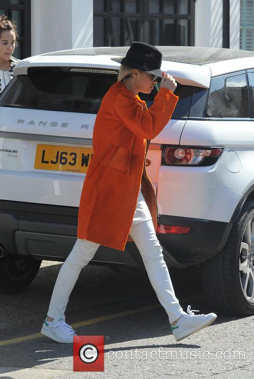 Rita Ora leaving her house and arriving at...
