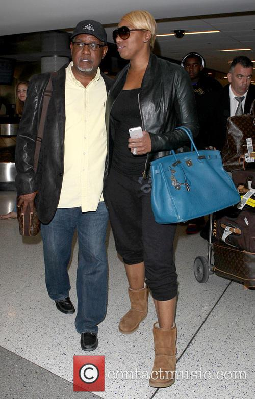 NeNe Leakes arrives at LAX carrying her Hermes...