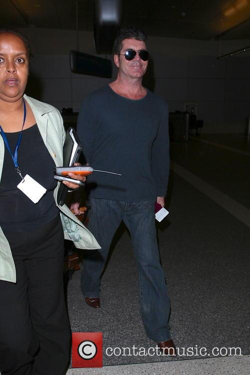 Simon Cowell arriving at LAX