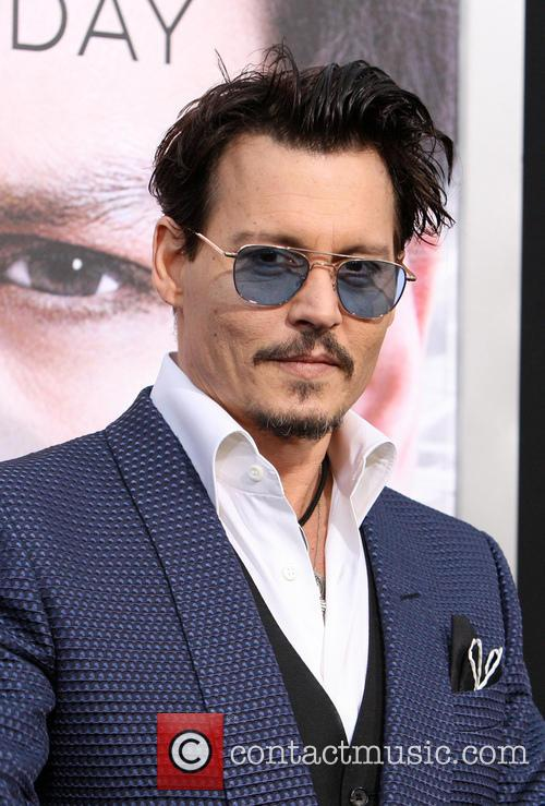 Johnny Depp at the premiere of Transcendence
