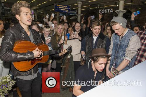 The Vamps are mobbed by fans as they...