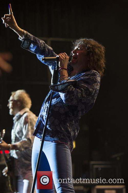 Foreigner performing live in concert