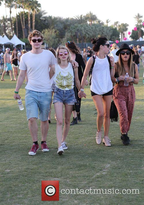 Emma Roberts enjoys her friends at Coachella day...
