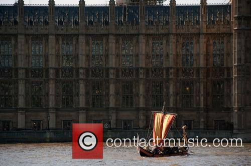 Viking boat sails along River Thames