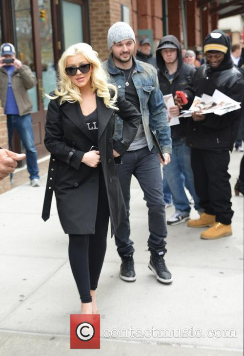 Christina Aguilera and husband leaving for the airport