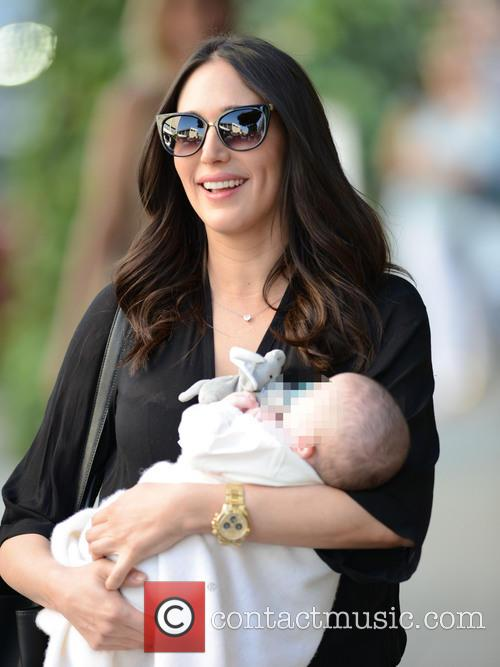 Lauren Silverman looking radiant while holding baby Eric...