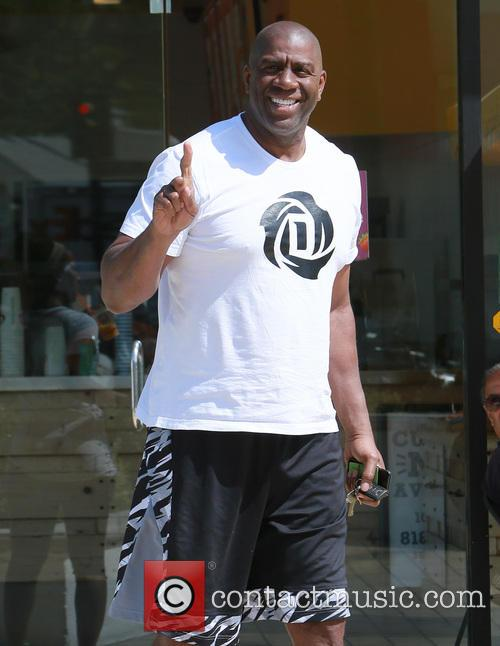 Magic Johnson and a friend leave Jamba Juice