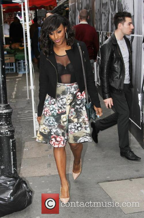 Alexandra Burke wears floral skirt and bra in...