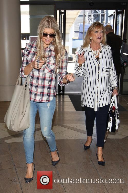 Fergie looks stylish as she arrives at LAX