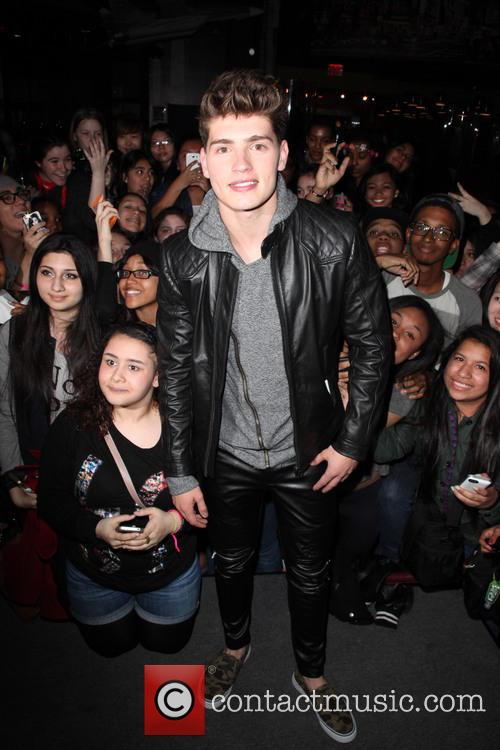 Gregg Sulkin at Planet Hollywood