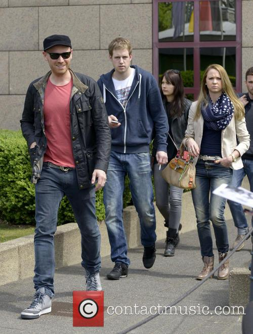 Coldplay leave the Hyatt Regency Cologne Hotel