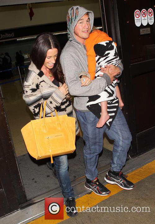 Alanis Morissette arrives at Los Angeles International (LAX)...