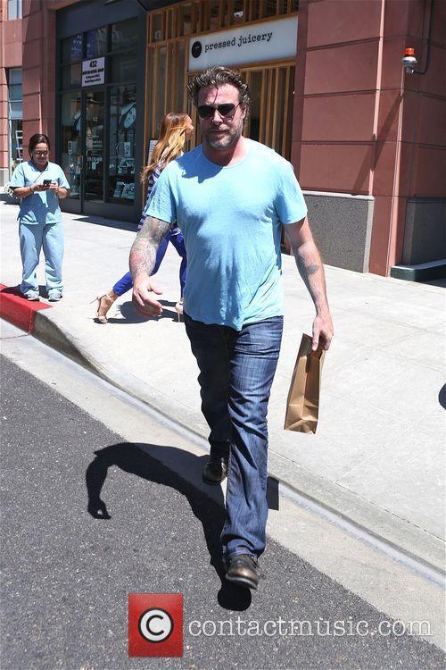 Dean McDermott seen giving a homeless man some...