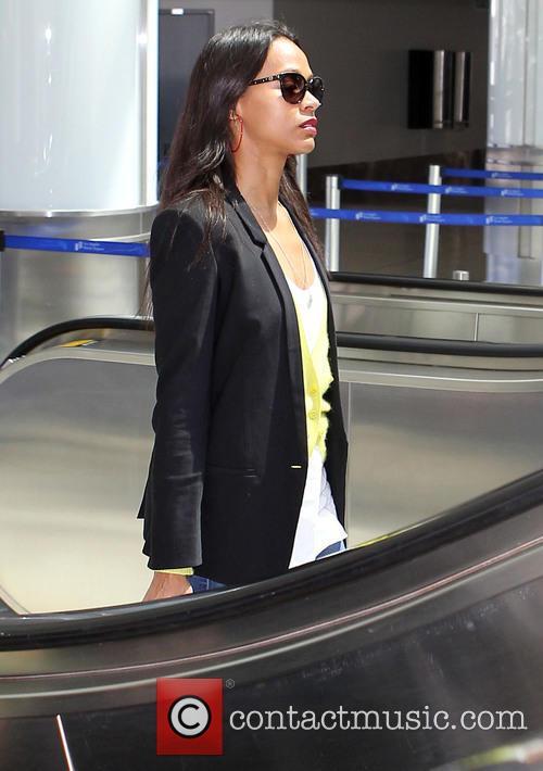 Zoe Saldana arrives at Los Angeles International (LAX)...