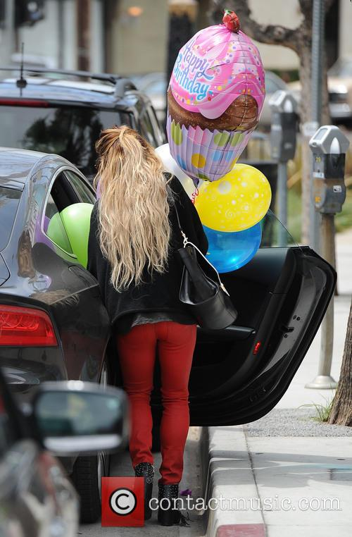 A blonde Vanessa Hudgens picks up birthday balloons