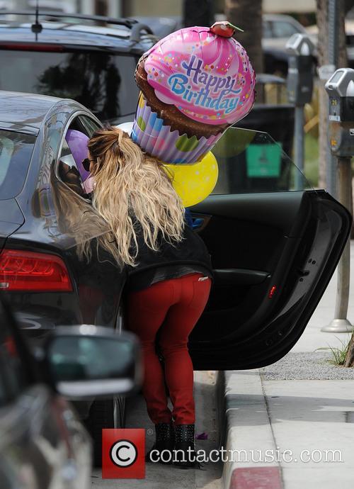 A blonde Vanessa Hudgens picks up birthday balloons