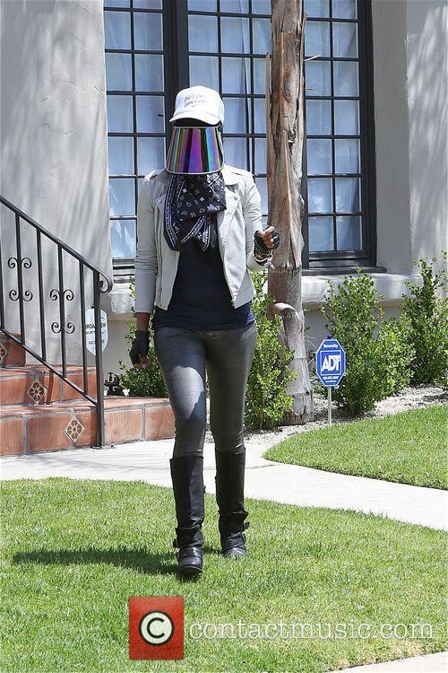 V. Stiviano departs her home wearing her visor
