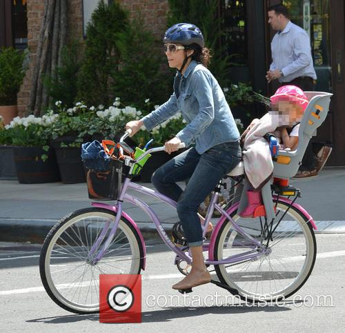 Bethenny Frankel Rides A Bicycle