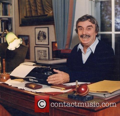 Leslie Thomas at his writing desk