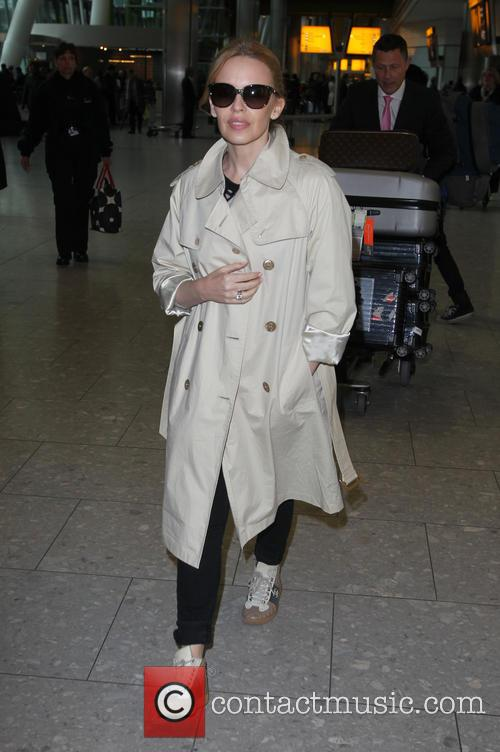 Kylie Minogue arriving at Heathrow Airport