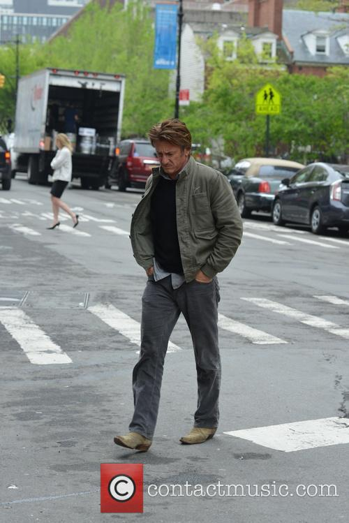 Sean Penn walking by himself in TriBeCa