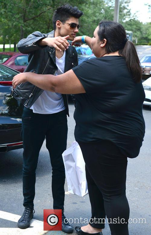 Siva Kaneswaran stops to chat to fans and...