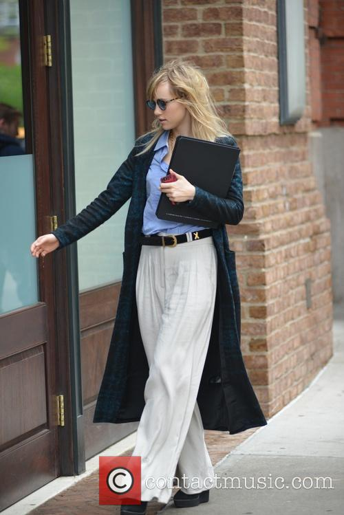 Model Suki Waterhouse entering her hotel