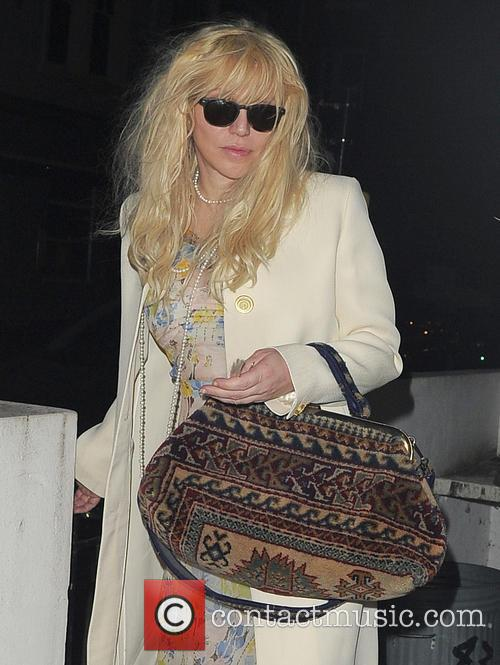 Courtney Love arrives home